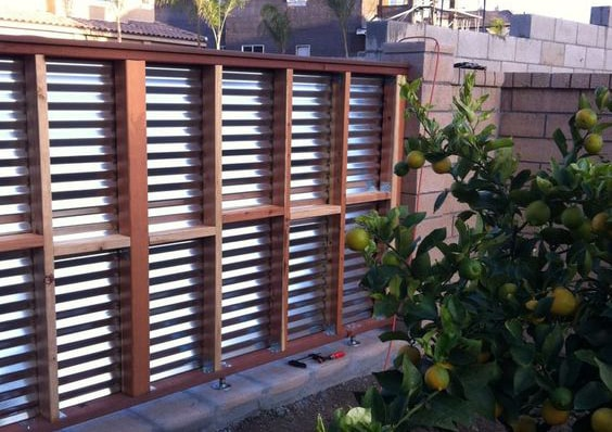 Corrugated metal panel fence